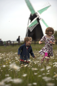 Children by the wind-pump at Wicken Fen National Nature Reserve, Cambridgeshire.