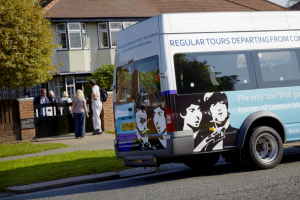 Visitors and the National Trust tour minibus at Mendips, the childhood home of John Lennon, in Woolton, Liverpool.