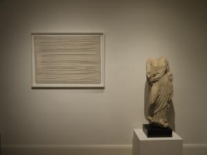 R+V WHITE show, 2012, an Achrome by Piero Manzoni alongside a Roman marble Vestal, II century AD.