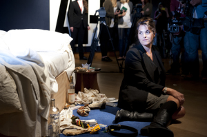 Tracey with 'My Bed' at Christie's © Tracey Emin, photo courtesy Edward Hopley