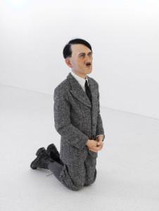 MAURIZIO CATTELAN Him, 2001 Polyester, wax, garment 39 3/4 x 16 1/8 x 20 7/8 inches (101 x 41 x 53 cm) © Maurizio Cattelan