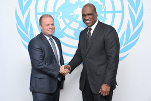 John Ashe (right), President of the sixty-eighth session of the General Assembly, meets with Joseph Muscat, Prime Minister of Malta. UN Photo/Evan SchneiderUnited Nations, New York, 25 September 2013