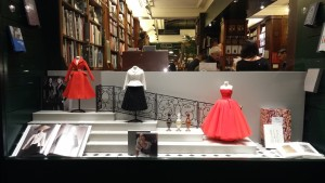 Display for Dior books with miniature dresses lent by the Dior Patrimonial Archives and perfume models of the Museum.