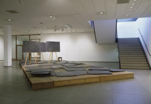 Joseph Beuys. Directive Forces [Richtkraefte], 1974-1977. 100 wood panels, 3 easels, 1 walking stick, 1 lightbox with photograph. Nationalgalerie, Staatliche Museen zu Berlin, Berlin