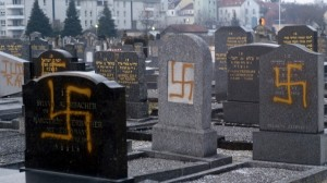 Desecrated graves in the main Jewish cemetery of Strasbourg, France, in 2010 (photo credit: AP/Christian Lutz)