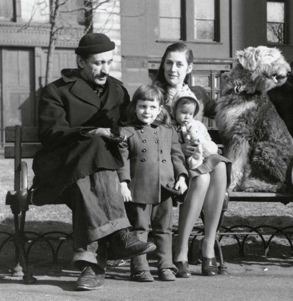 The artist Arshile Gorky with his young family.