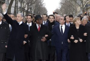 French President Francois Hollande (2nd R) is surrounded by heads of state including (L to R) European Commission President European Commission President Jean-Claude Juncker, Israel's Prime Minister Benjamin Netanyahu, Mali's President Ibrahim Boubacar Keita, Germany's Chancellor Angela Merkel, as they attend the solidarity march (Marche Republicaine) in the streets of Paris January 11, 2015. French citizens will be joined by dozens of foreign leaders, among them Arab and Muslim representatives, in a march on Sunday in an unprecedented tribute to this week's victims following the shootings by gunmen at the offices of the satirical weekly newspaper Charlie Hebdo, the killing of a police woman in Montrouge, and the hostage taking at a kosher supermarket at the Porte de Vincennes. AFP PHOTO POOL PHILIPPE WOJAZER